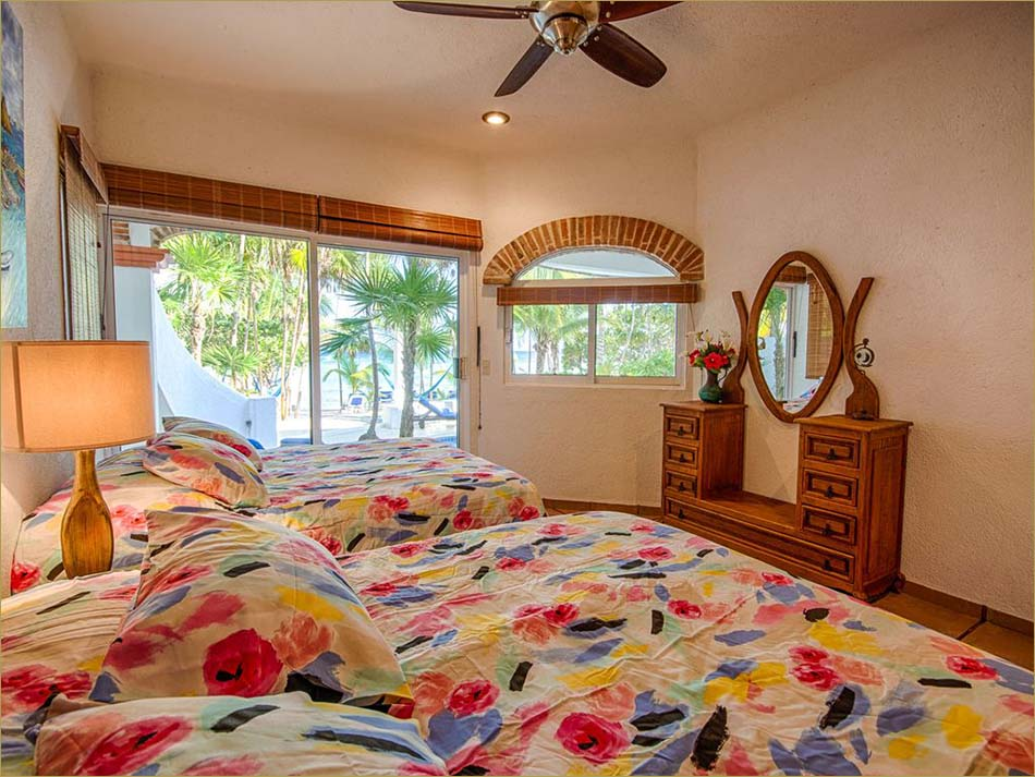 Lower level third bedroom encludes a private bathroom and pool side patio overlooking beach.