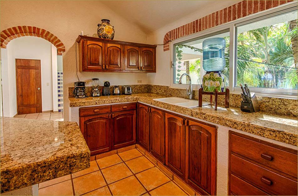 Gourmet kitchen with profession appliances, granite countertops and stone tile floors.