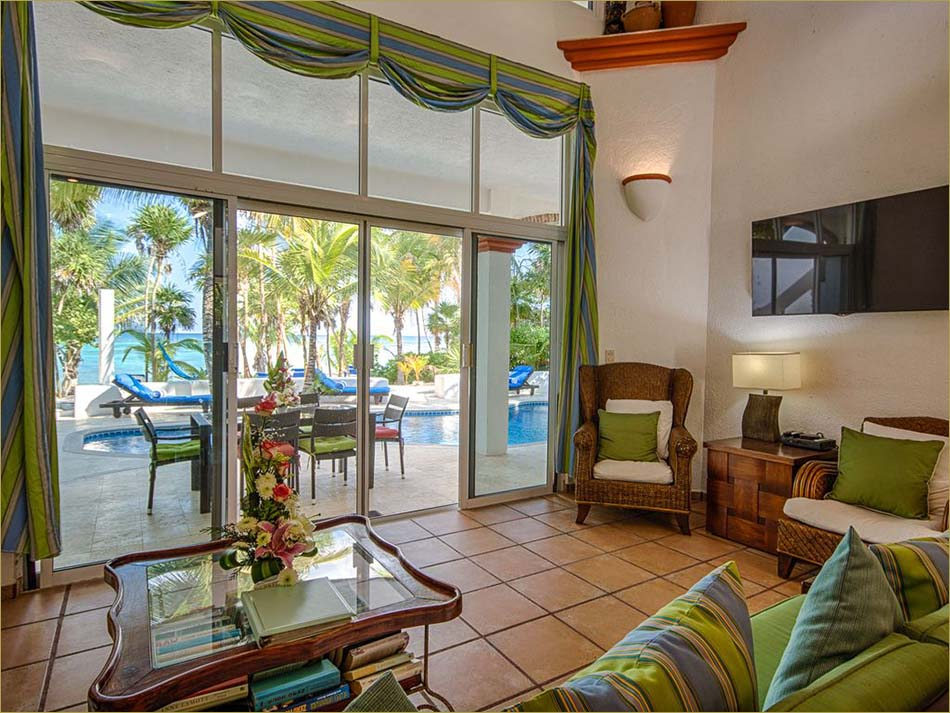 Spacious open living room with direct access to the pool and beachfront